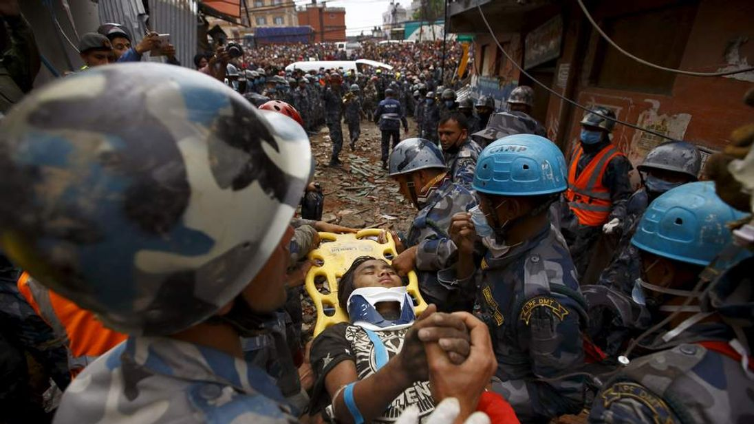 Earthquake survivor Pema Lama is rescued by the Armed Police Force from the collapsed Hilton Hotel six days after Saturday's earthquake, in Kathmandu