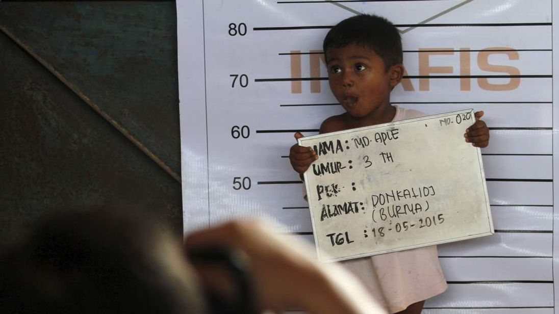 A Rohingya child who recently arrived by boat has his picture taken for identification purposes at a shelter in Kuala Langsa, in Indonesia's Aceh Province