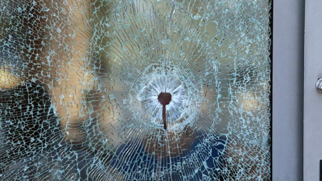 A broken glass window of the Imperiale Marhaba hotel is seen after a gunman opened fire at the beachside hotel in Sousse, Tunisia