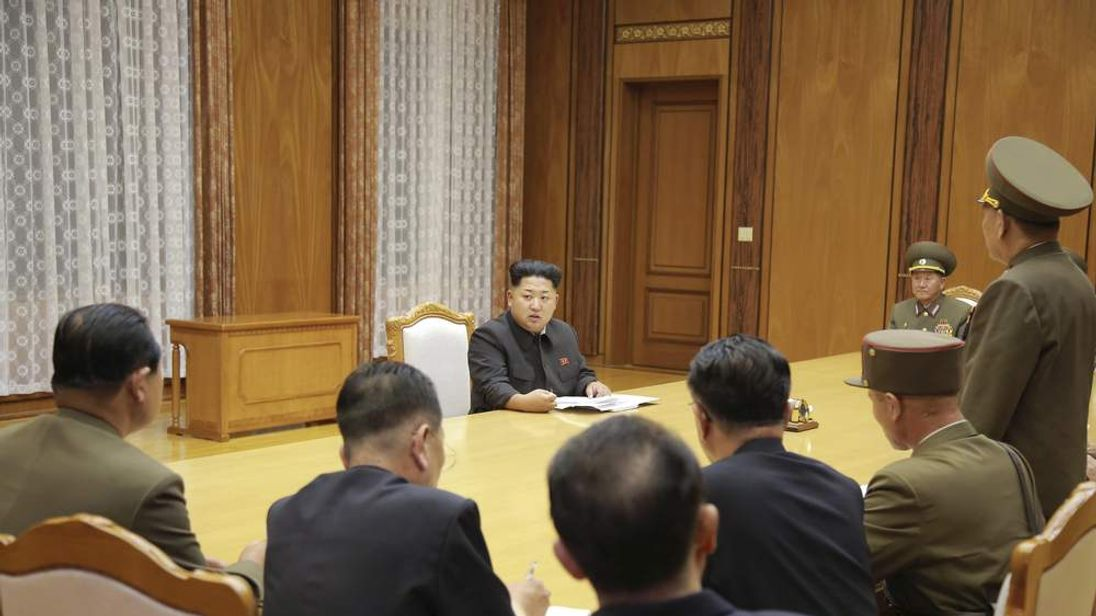 KCNA picture shows North Korean leader Kim Jong Un speaking at an emergency meeting of the Workers' Party of Korea Central Military Commission