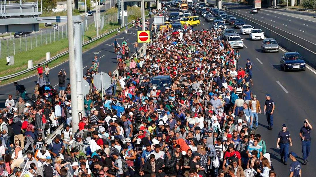 Migrants march along highway out of Budapest for the border with Austria