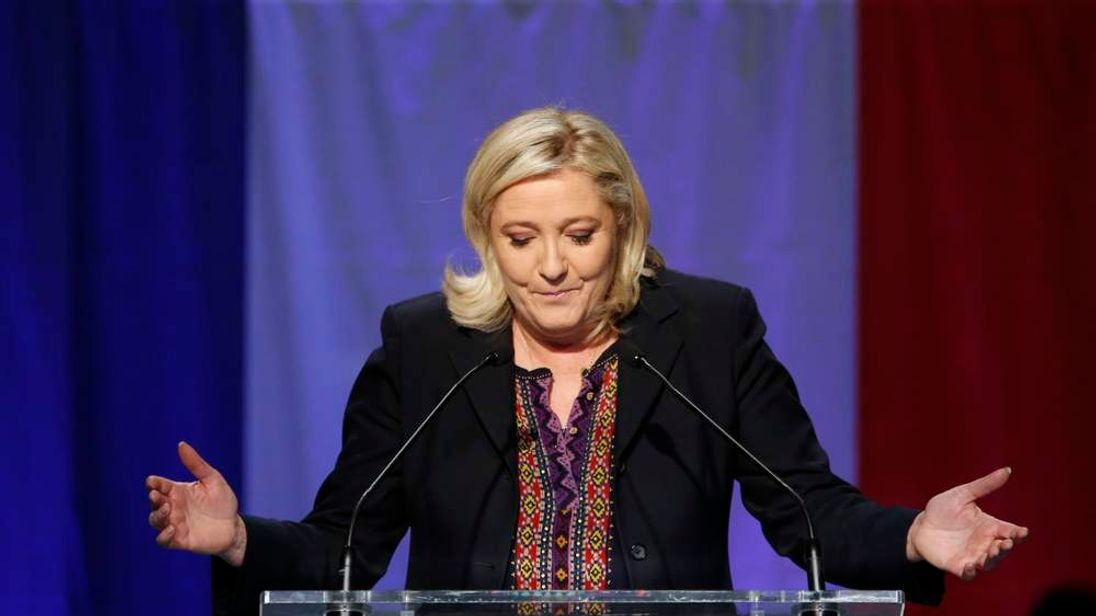 French National Front political party leader and candidate Marine Le Pen delivers a speech after results in the Nord-Pas-de-Calais-Picardie region for the second-round regional elections in Henin-Beaumont