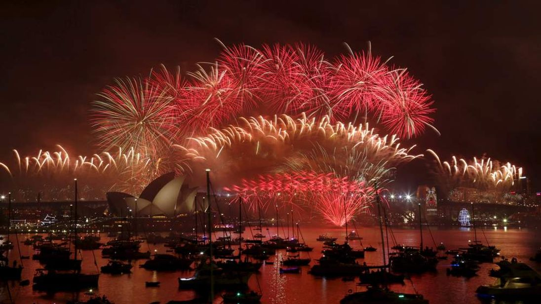 Fireworks explode over the Sydney Opera House and Harbour Bridge