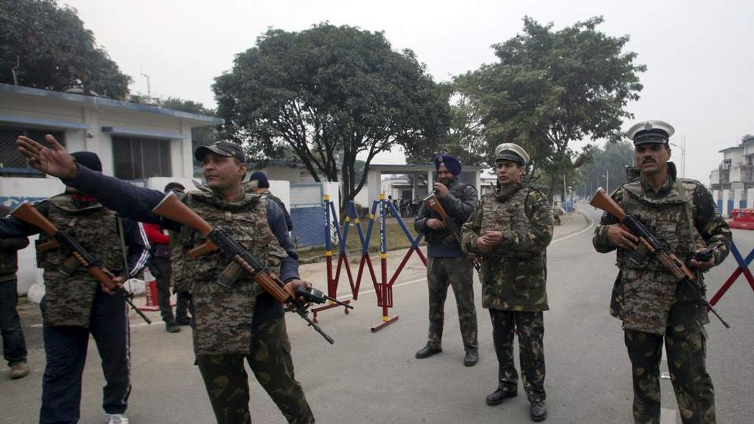 Indian security personnel stand guard at air base in Pathankot