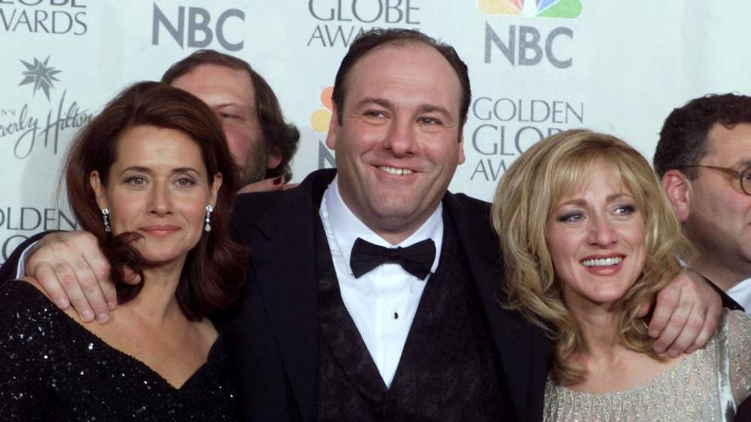 James Gandolfini with Lorraine Bracco (L) and Edie Falco (R), his co-stars in The Sopranos