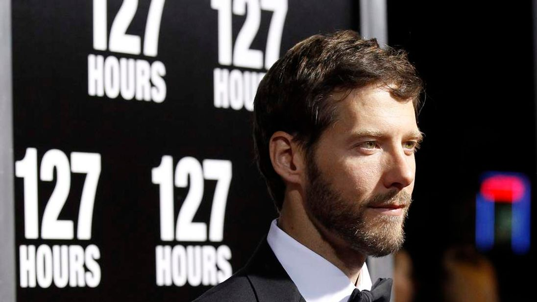 "Aron Ralston poses at the premiere of ""127 Hours"" at the Samuel Goldwyn theatre in Beverly Hills"