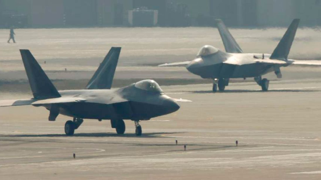 F-22 stealth fighter jets belonging to the U.S. Air Force move to take off at a U.S. air force base in Osan