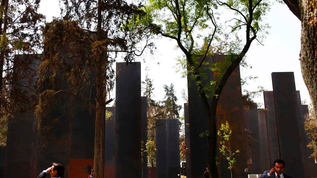 """People are seen during the inauguration of """"Memorial to Victims of Violence in Mexico"""" monument in Mexico City"""