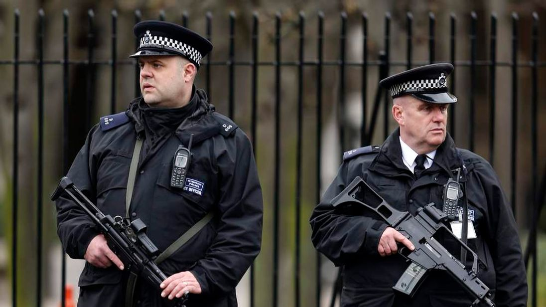 Police officers stand guard