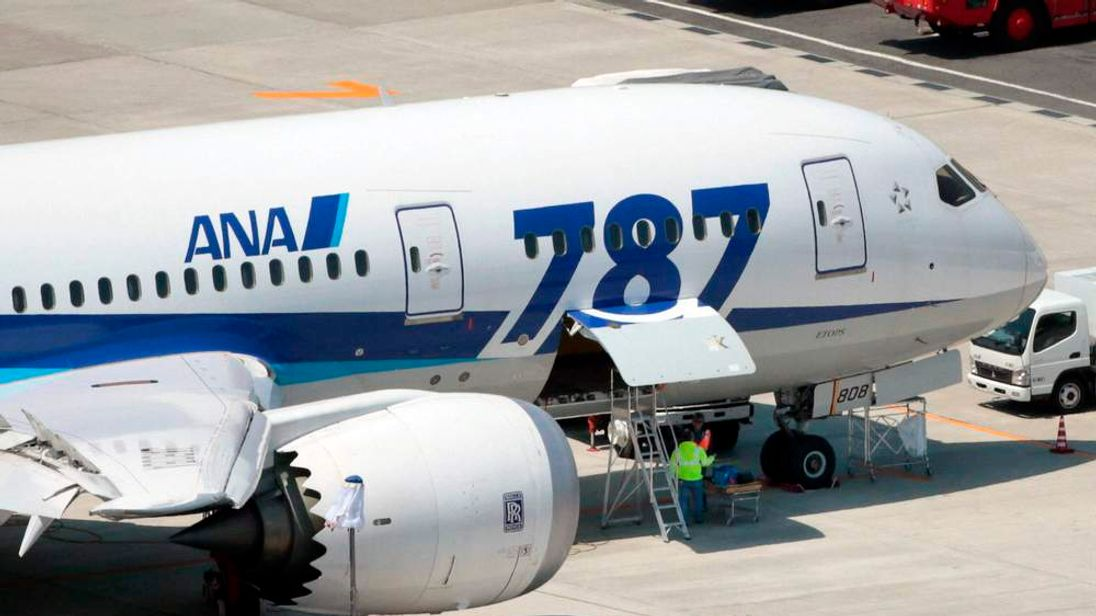 An ANA's Boeing Co's 787 Dreamliner plane receives restoration work at Okayama airport in Okayama, Japan