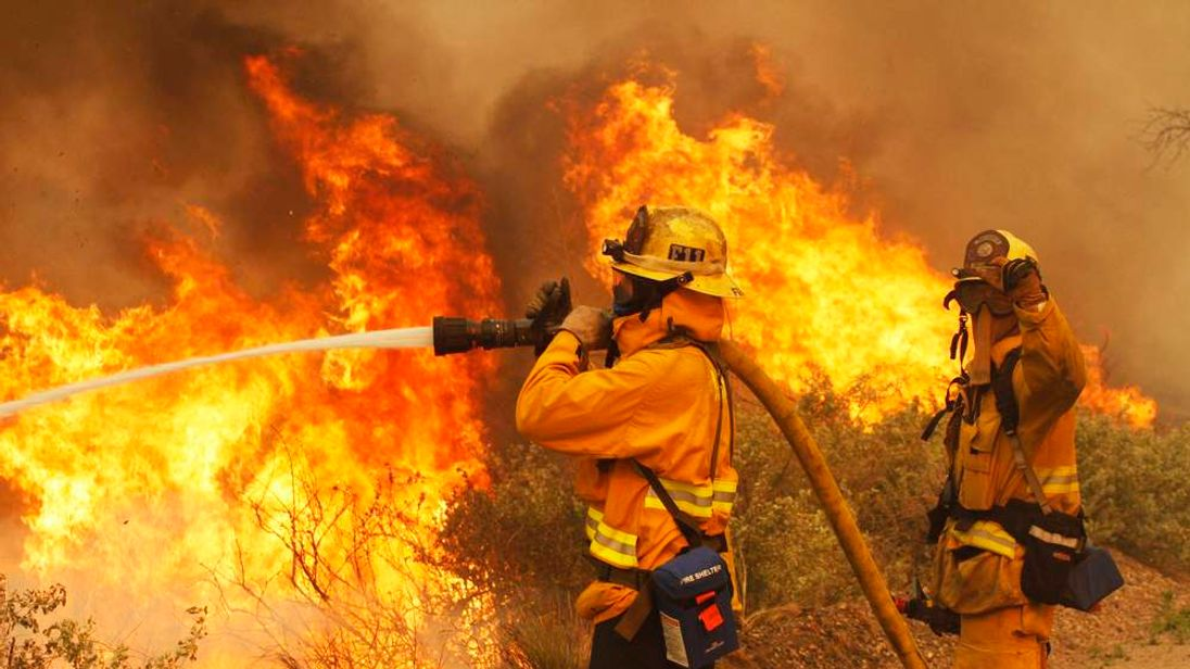 Firefighters battle the Springs Fire at Point Mugu State Park