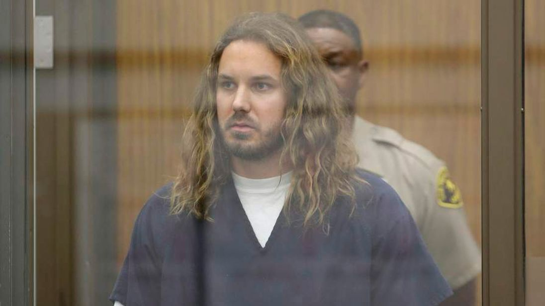 Lambesis, lead singer for the heavy metal band As I Lay Dying, is arraigned in San Diego North County court in California