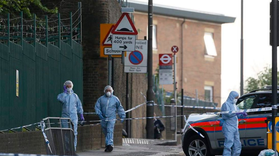 Police forensics officers at machete murder scene in Woolwich