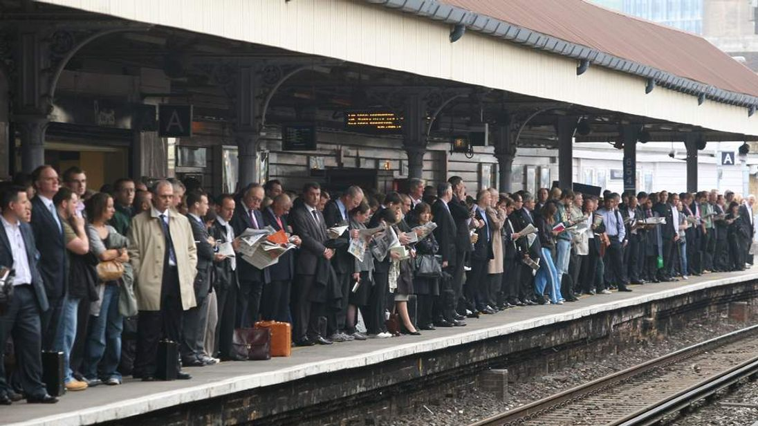 Commuters queue wait for trains at Water