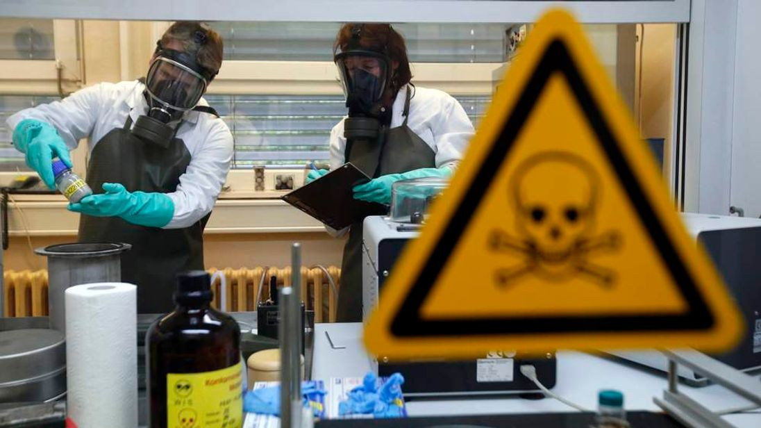 Employees of  WIS check a dummy sample contaminated with a substance similar to the chemical weapon Sarin during a demonstration in Munster