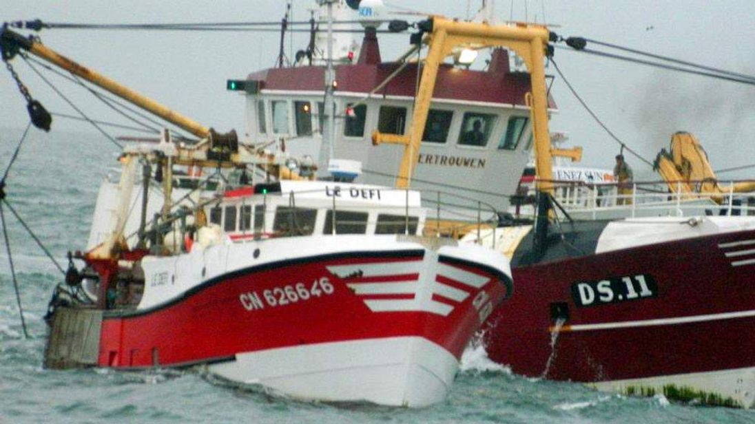 UK scallop fishermen surrounded