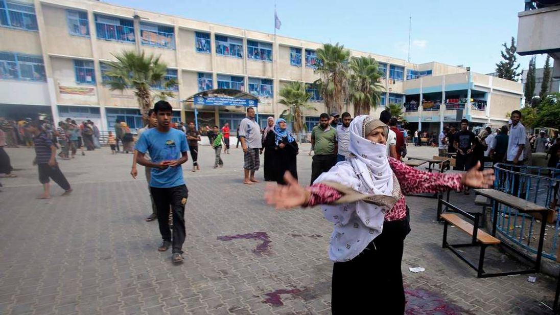 A Palestinian woman at a UN school said to have been attacked in an Israeli airstrike.