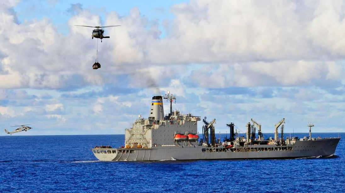 US Navy handout: USNS John Ericsson providing fuel and logistics replenishments to naval ships and helicopters aiding in search for missing Malaysia flight