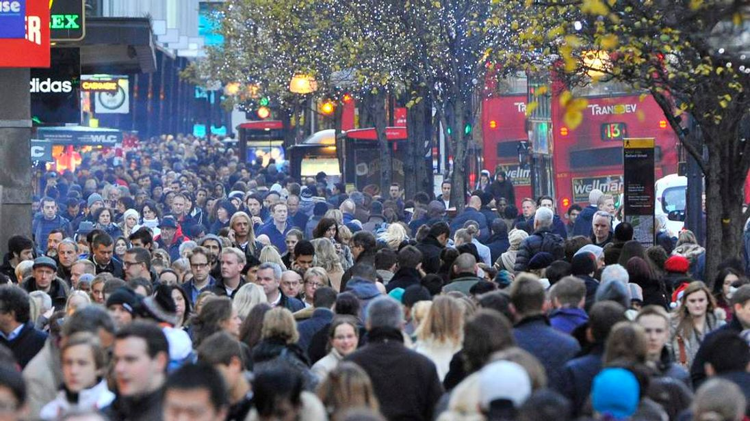 Pre-Christmas shoppers walk along Oxford Street in central London