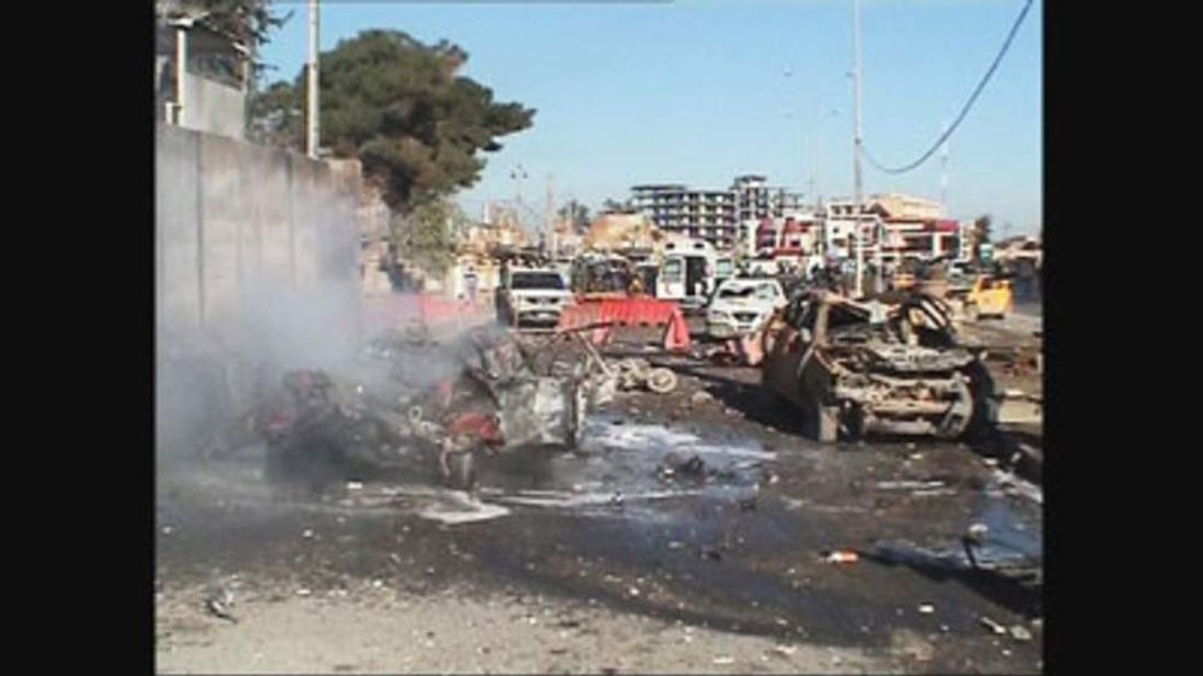 A suicide car bombing and gun attack on a police base in the northern city of Kirkuk in Iraq