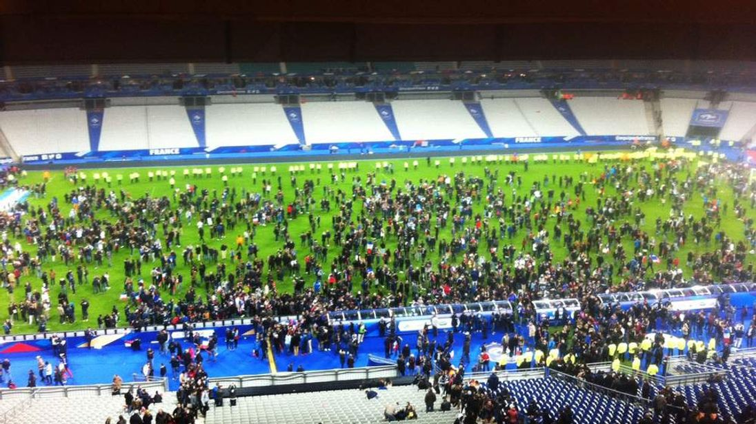 Spectators on the pitch of the Stade de France stadium