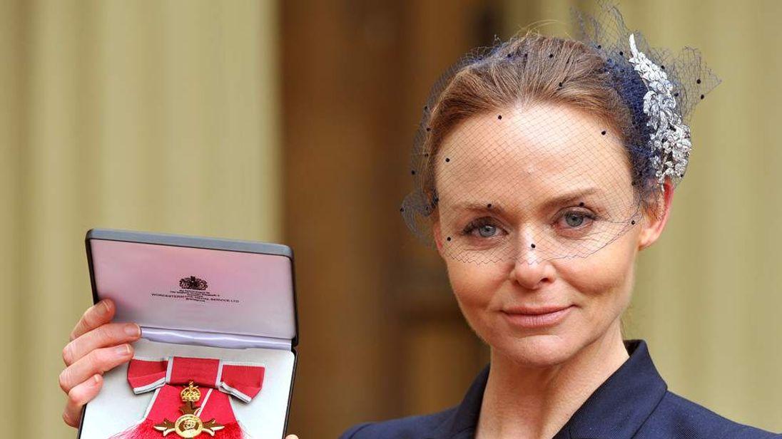 Fashion designer Stella McCartney holds her Officer of the British Empire (OBE) award.