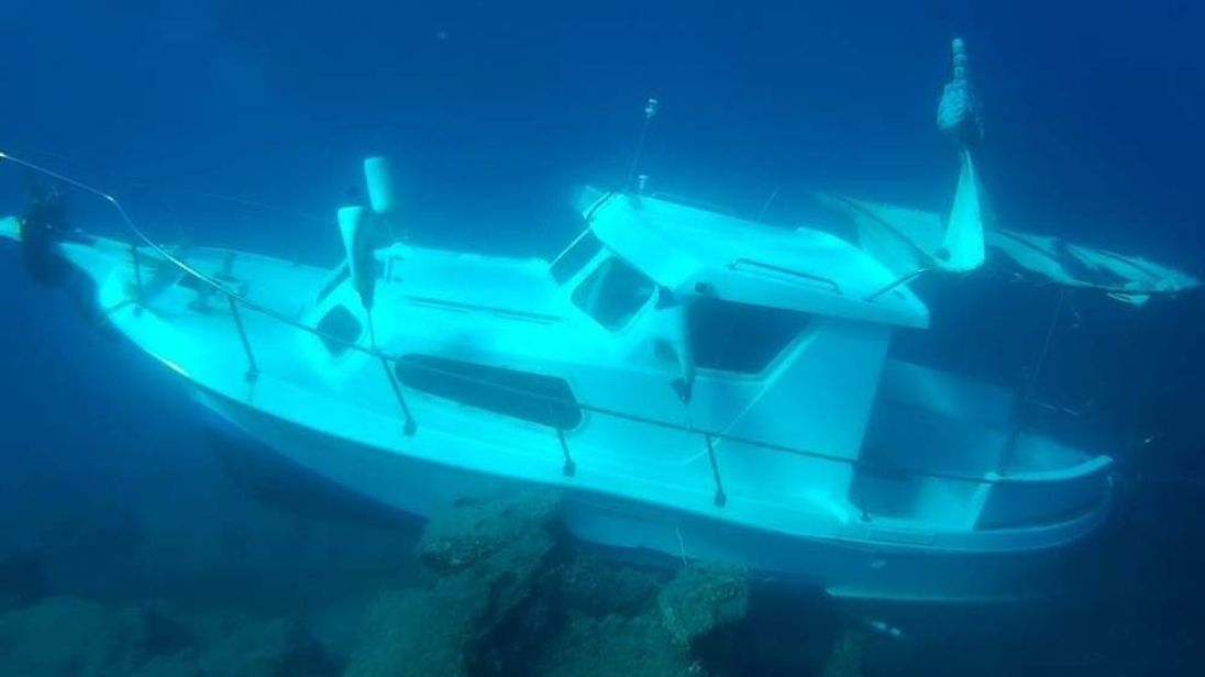 Sunken boat in Samos, Greece