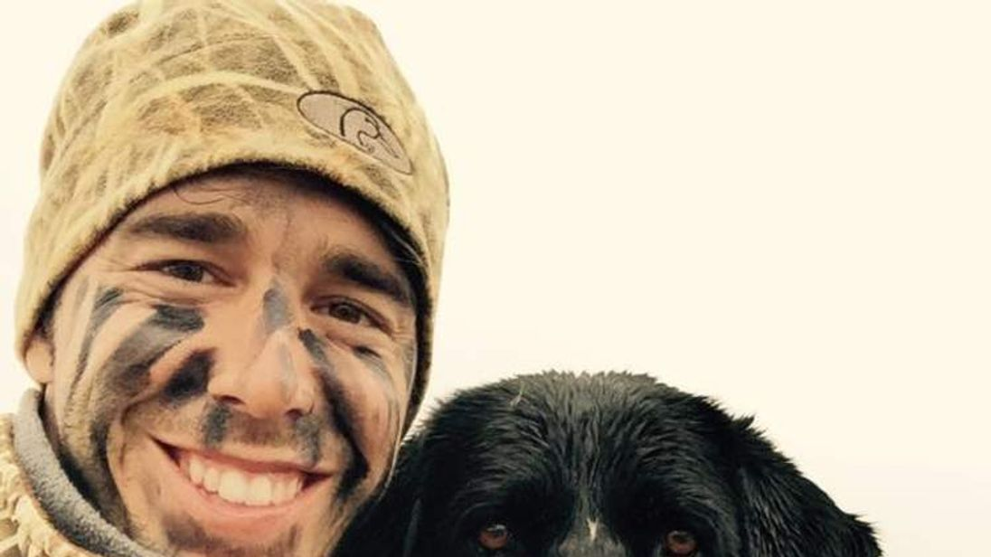 """Craig Strickland and his duck hunting dog """"Sam"""""""