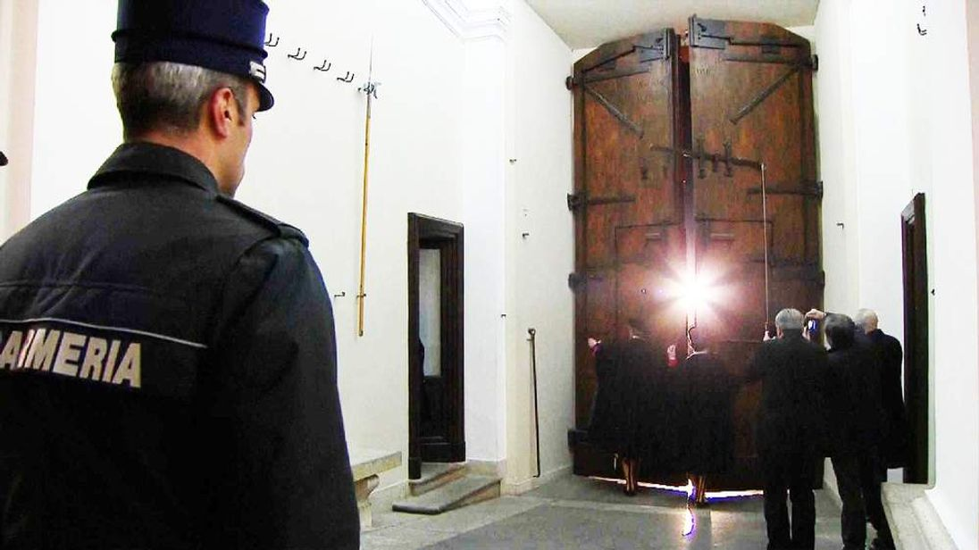 Swiss Guards close the doors and hand over watch of Castel Gondolfo to the Italian police.