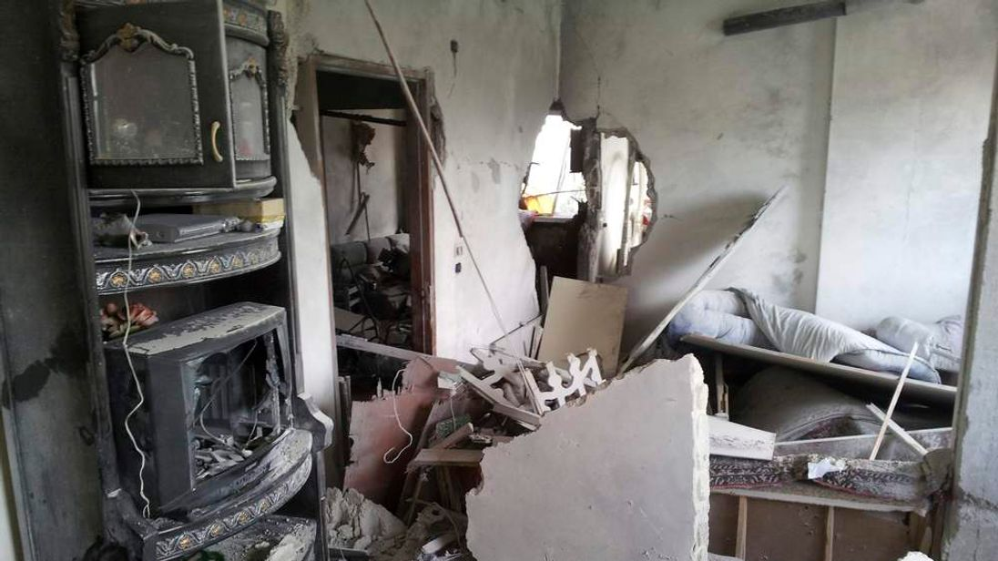 A view of a house damaged by missiles in Jubar