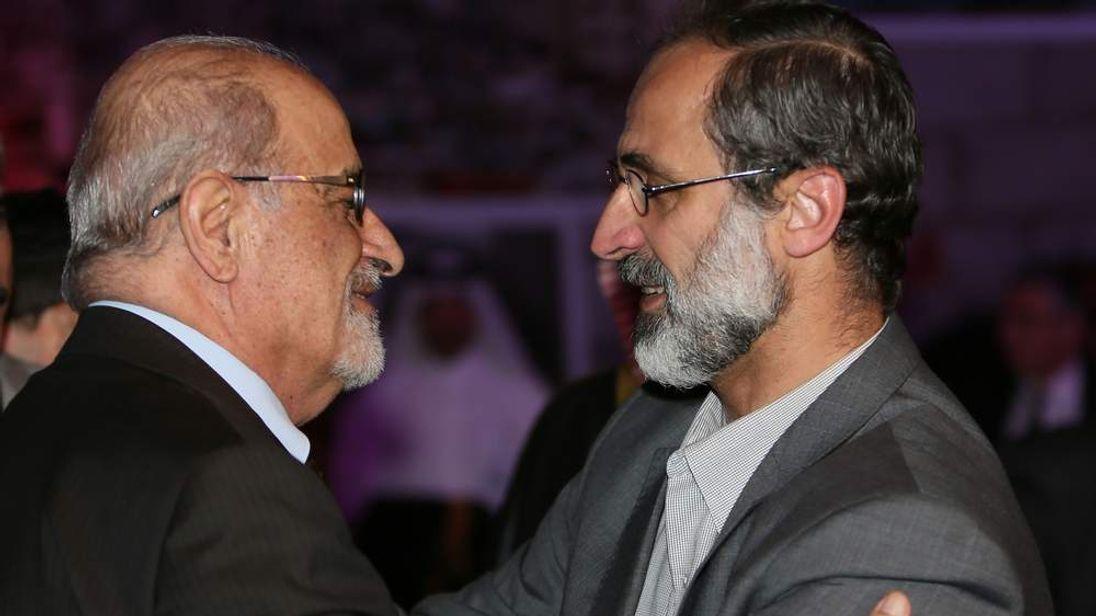 Syrian cleric Ahmed Moaz al-Khatib (right) and  Syrian human rights activist Haytham al-Maleh