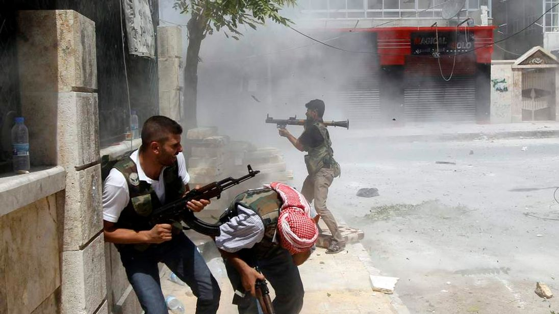 Syrian Free Fighters battle in the streets
