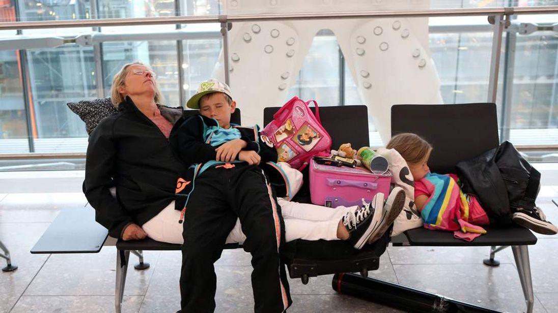 A sleeping family at Heathrow