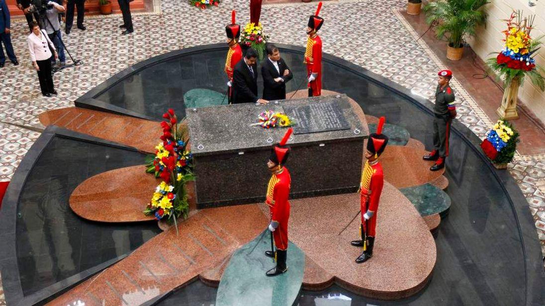 Venezuela's President Nicolas Maduro and Ecuador's President Rafael Correa visit the tomb of late President Hugo Chavez at the 4F military fort in Caracas
