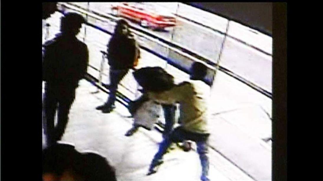 A Columbian thief mugs a woman at a bus station