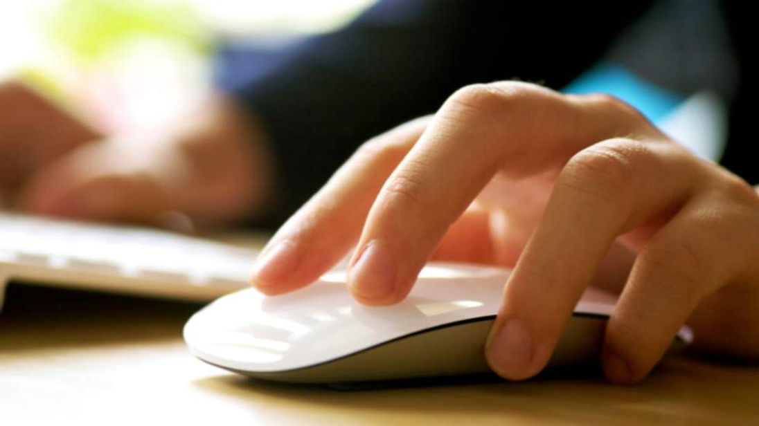 Hand on a computer mouse