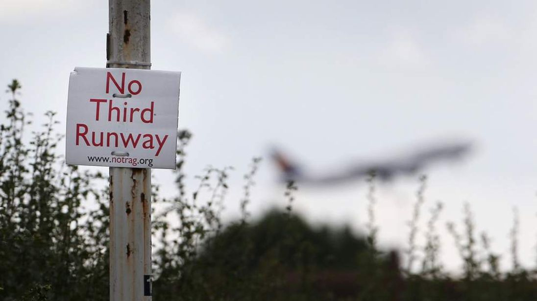 A protest sign is displayed in an area that would be demolished for a third runway near Heathrow Airport