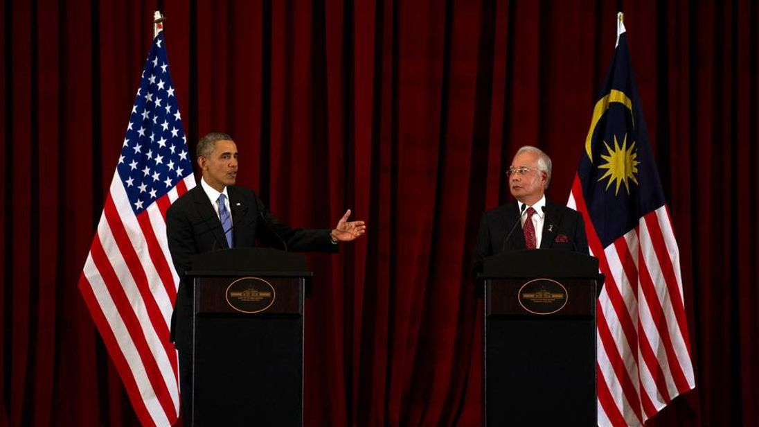Barack Obama and Malaysia's Prime Minister Najib Razak at a news conference