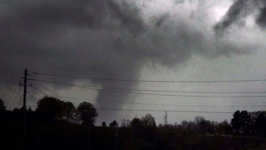 A funnel cloud is spotted moving east over Highway 5 near Rosebud