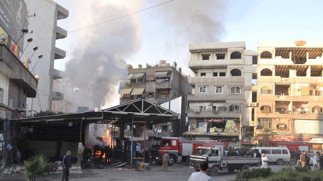 The scene of a car bomb explosion in Jaramana, Damascus