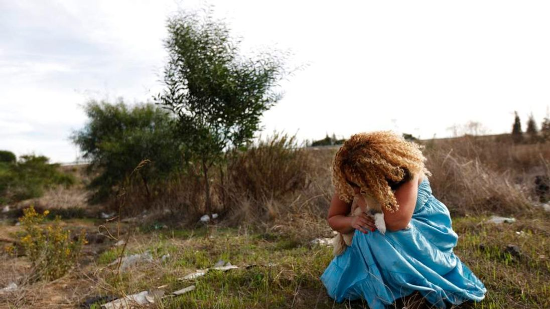 Woman cowers from rocket attack in Ashkelon