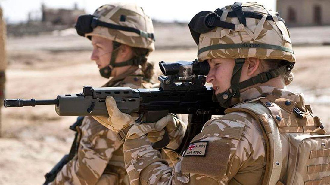 British Female Soldiers On Patrol In Afghanistan
