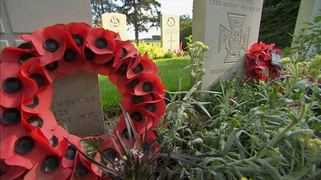 Poppies decorate graves at a World War One cemetery in Belgium
