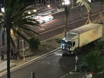 Picture from @Nice_Matin Twitter account showing a damaged truck in the aftermath