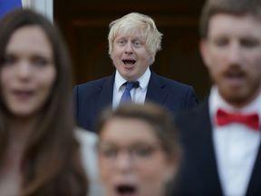 Boris Johnson sings the French national anthem on Thursday evening