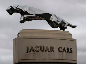 The Jaguar emblem is seen at the gates of its Castle Bromwich plant in Birmingham