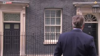 The PM sings to himself as he walks back into Number 10 after announcing he will be out in two days