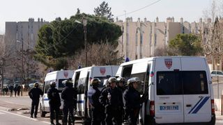 French CRS riot police officers secure the access to the Castellane housing area in Marseille