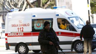Police office secures area after an explosion near the Ottoman-era Sultanahmet mosque in Istanbul