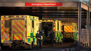 A patient is taken from a ambulance parked outside the Accident and Emergency department  of Gloucestershire Royal Hospital